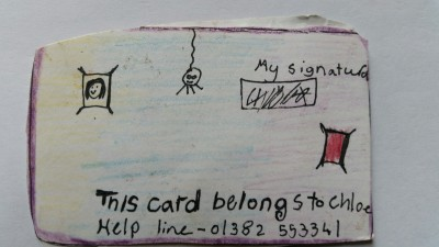 Chloe's smartcard: note useful helpline and spider